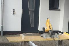 Porte d'entrée avec cadre inox